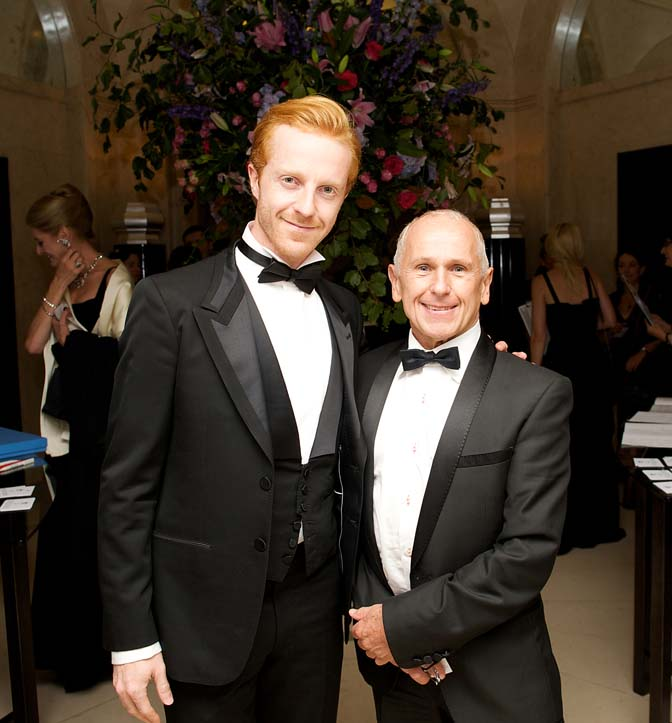 Two male guests in black tie posing for the camera