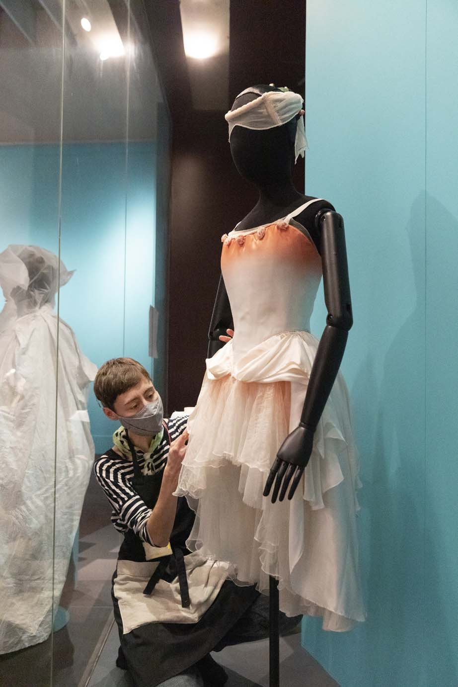 Conservator, Gesa, installing Darcey Bussell's costume worn as Belle Rose in The Prince of the Pagodas 1989