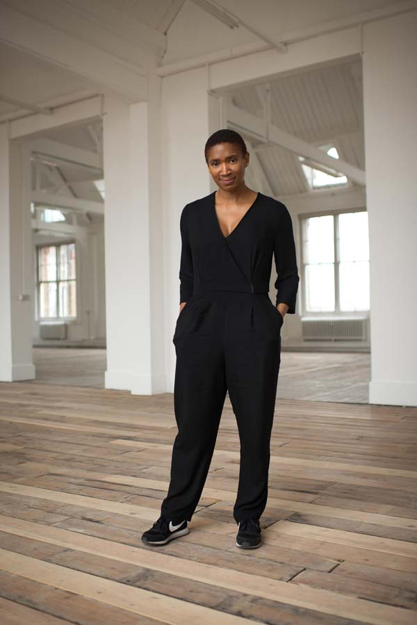 Coral Messam in black outfit standing in a studio